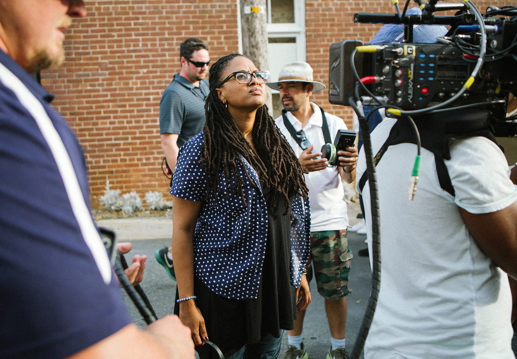 """. In this image released by Paramount Pictures, director Ava DuVernay  appears on the set during the filming of \""""Selma.\"""" DuVernay was nominated for a Golden Globe for best director for the film on Thursday, Dec. 11, 2014. The 72nd annual Golden Globe awards will air on NBC on Sunday, Jan. 11. (AP Photo/Paramount Pictures, Atsushi Nishijima)"""