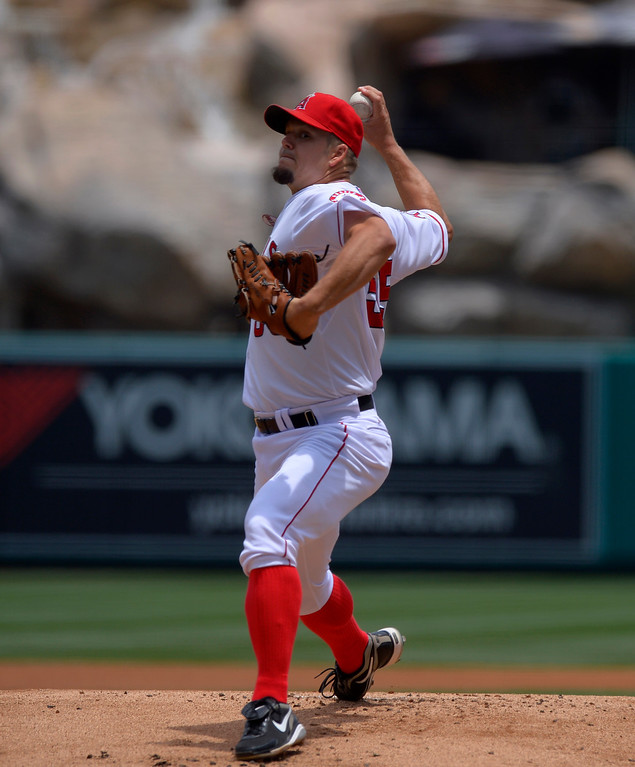 . Los Angeles Angels starting pitcher Joe Blanton throws to the plate during the first inning of their baseball game against the Pittsburgh Pirates, Sunday, June 23, 2013, in Anaheim, Calif.  (AP Photo/Mark J. Terrill)