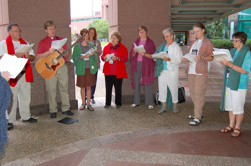 Good Soil members sing outside the Minneapolis Convention Center prior to the morning's plenary session.