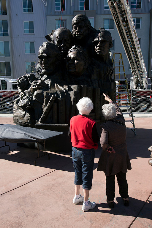 """. Unidentified spectators take in the sight of Mario Chiodo\'s \""""Remember Them\"""" statue, at a ceremony to dedicate the fourth and final section of the artist tribute to heroes of civil rights and humanity, Thursday, Feb. 21, 2013 in Oakland Calif. (D. Ross Cameron/Staff)"""