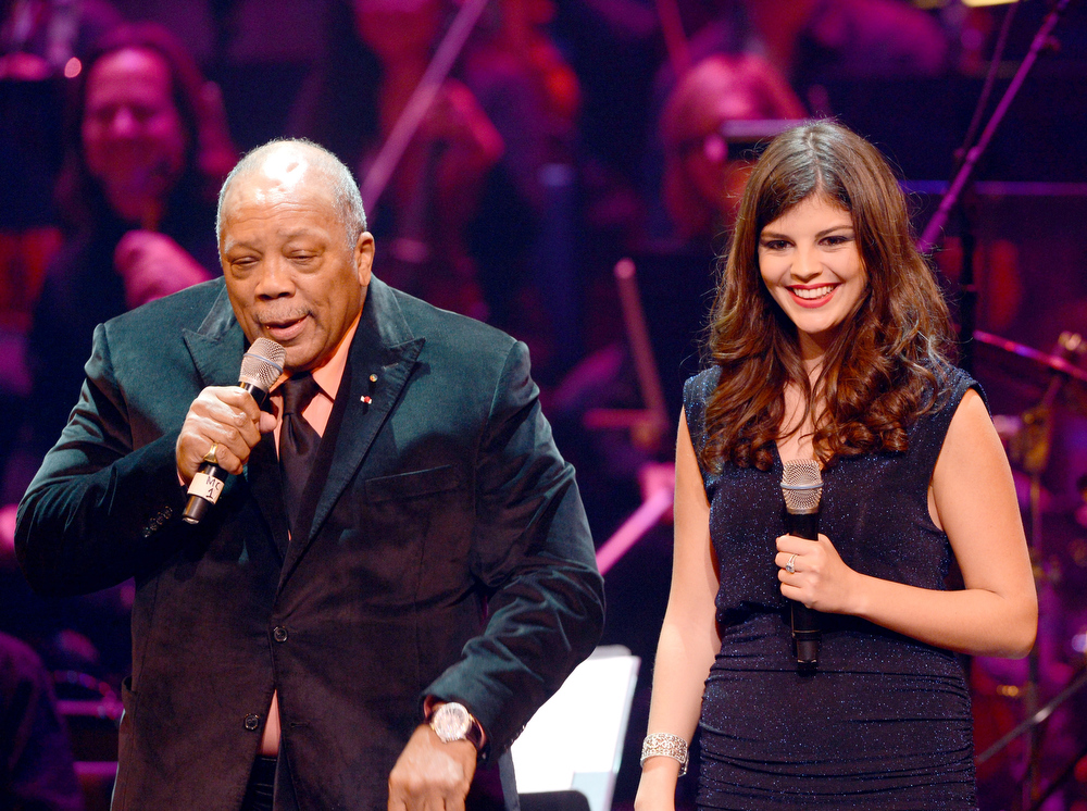 Description of . Quincy Jones (L) and Nikki Yanofsky attend a celebration of Carole King and her music to benefit Paul Newman's The Painted Turtle Camp at the Dolby Theatre on December 4, 2012 in Hollywood, California.  (Photo by Michael Buckner/Getty Images for The Painted Turtle Camp)