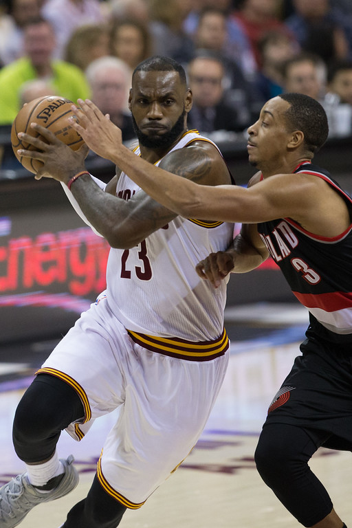 . Michael Johnson - The News-Herald Lebron James of the Cleveland Cavaliers (23) drives by CJ McCollum (3) during a home game against the Portland Trailblazers on November 23, 2016 at the Quicken Loans Arena.