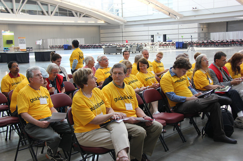 Guidebook volunteers meeting before the Assembly opens.