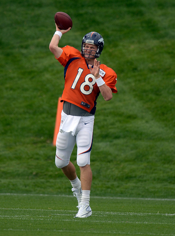 . Denver Broncos quarterback Peyton Manning (18) throws a pass in drills during practice September 19, 2013 at Dove Valley. (Photo by John Leyba/The Denver Post)
