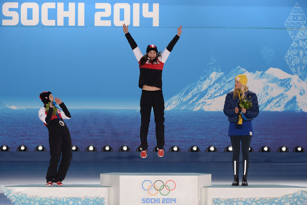 . A picture taken with a robotic camera shows (from L) Canada\'s silver medallist Kelsey Serwa, Canada\'s gold medallist Marielle Thompson and Sweden\'s bronze medallist Anna Holmlund posing during the Women\'s Freestyle Skiing Ski Cross Medal Ceremony at the Sochi medals plaza during the Sochi Winter Olympics on February 21, 2014.  AFP PHOTO / ANTONIN  THUILLIER/AFP/Getty Images