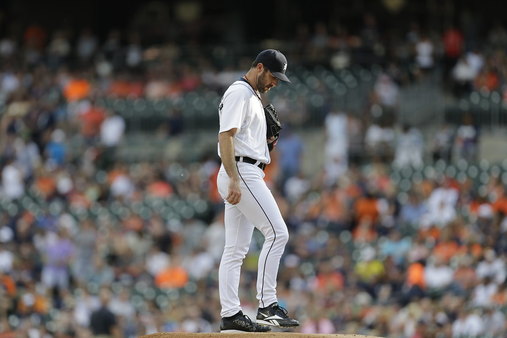 . Detroit Tigers pitcher Justin Verlander readies himself before pitching against the Kansas City Royals in the first inning of a baseball game in Detroit, Monday, June 16, 2014.  (AP Photo/Paul Sancya)