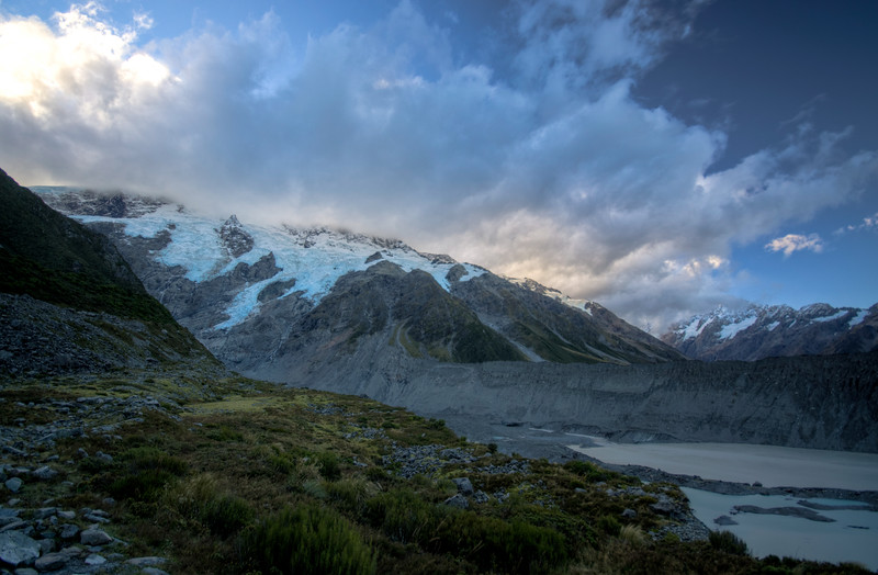 Mount Sefton viewed from Kea Point, in the Mount Cook National Park, hidden behind a layer of cloud backscatting the sunlight.