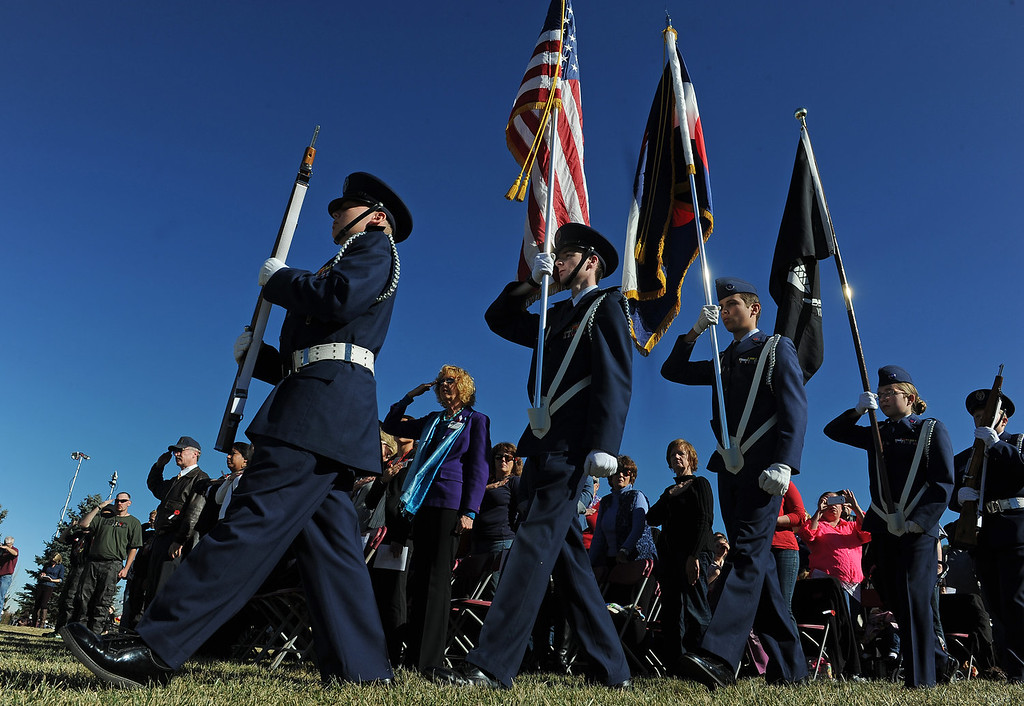 """. Members of the Broomfield Composite Squadron Civil Air Patrol had the honor of presenting the colors during the 36th annual Remembrance ceremony of Veteran\'s Day at Fort Logan Cemetery in Lakewood, CO  on November 11, 2013. The day was marked with a 21 gun rifle salute, \""""Echo taps\"""" played by buglers and the release of white birds of freedom.  The benediction was given by Jackie Newlander.  (Photo By Helen H. Richardson/ The Denver Post)"""