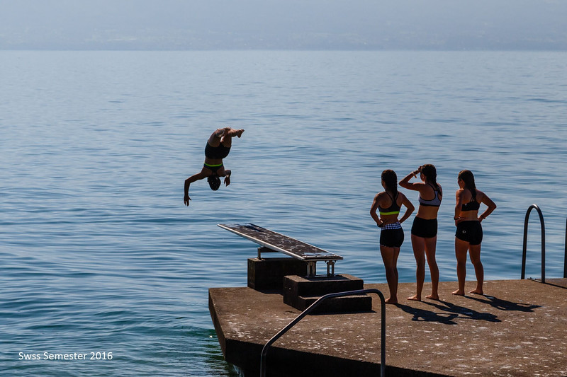 Bella doing a flip into Lac Lemon with Whitney, Peyton, and Penelope looking on
