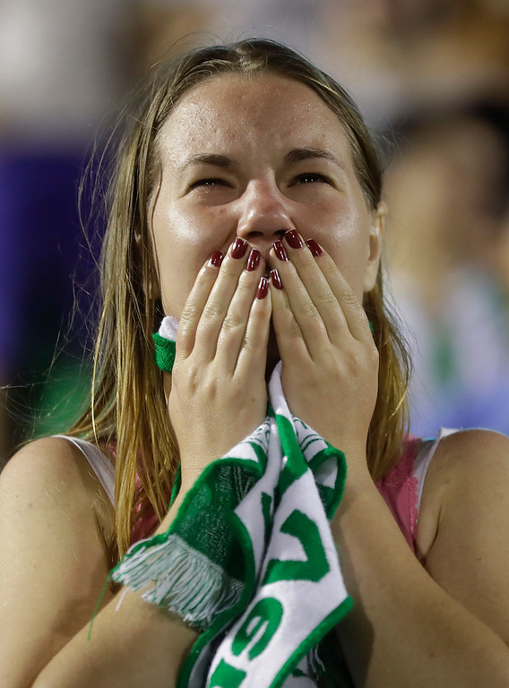 . A fan of Brazil\'s soccer team Chapecoense mourns during a gathering inside Arena Conda stadium in Chapeco, Brazil, Tuesday, Nov. 29, 2016. A chartered plane carrying the Brazilian soccer team Chapecoense to the biggest match of its history crashed into a Colombian hillside and broke into pieces on Tuesday, killing most passengers, Colombian officials said. (AP Photo/Andre Penner)