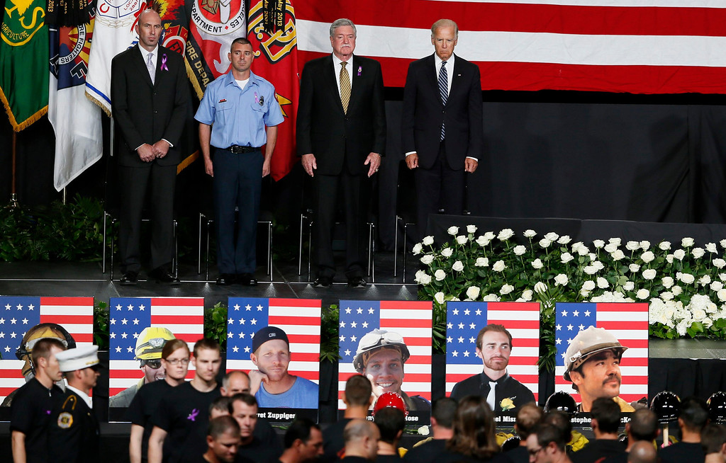 . Vice President Joe Biden (R) watches as firefighters file in at a memorial service for the fallen members of the Granite Mountain Hotshots, in Prescott Valley, Arizona July 9, 2013. REUTERS/Lucy Nicholson