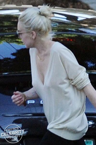 EXC: Lindsay Lohan Checks Her Porsche For Problems in LA