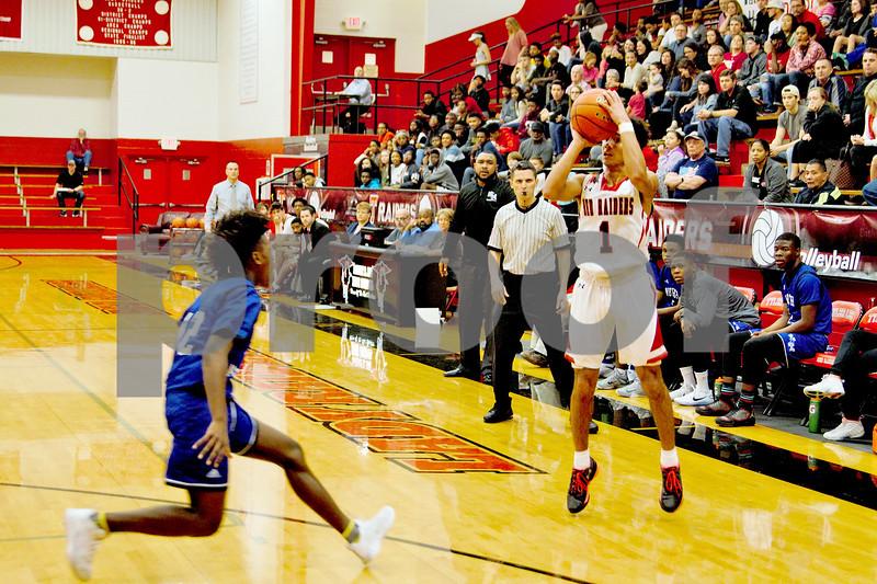 #1 Senior Isaiah Davison shoots from the 3 line