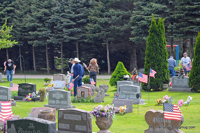 Legion members placing flags at the graves of veterans