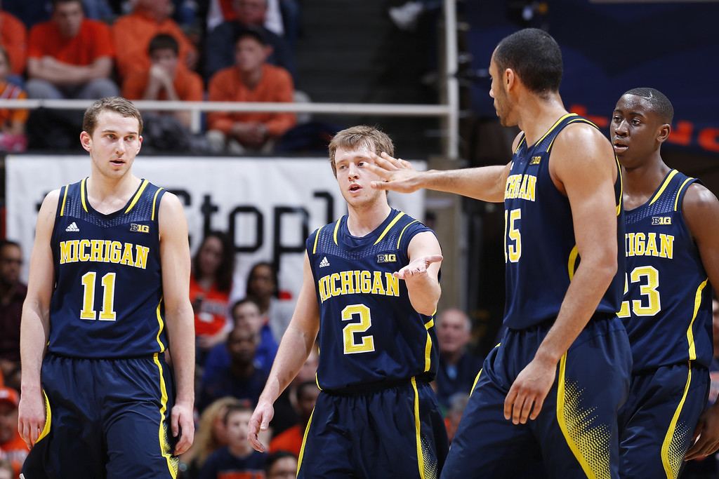 . CHAMPAIGN, IL - MARCH 4:  Spike Albrecht #2, Jon Horford #15, Nik Stauskas #11 and Caris LeVert #23 of the Michigan Wolverines celebrate during the game against the Illinois Fighting Illini at State Farm Center on March 4, 2014 in Champaign, Illinois. Michigan defeated Illinois 84-53. (Photo by Joe Robbins/Getty Images)
