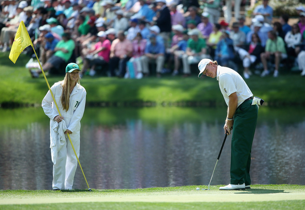 . Ernie Els of South Africa waits with his daughter Samantha during the Par 3 Contest prior to the start of the 2014 Masters Tournament at Augusta National Golf Club on April 9, 2014 in Augusta, Georgia.  (Photo by Andrew Redington/Getty Images)