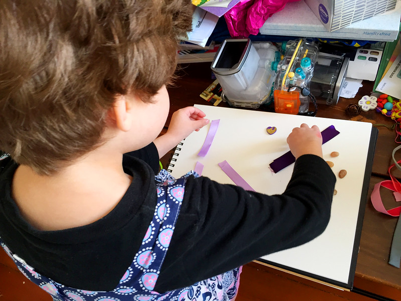 Gates arranges the materials she wants to use in her collage.