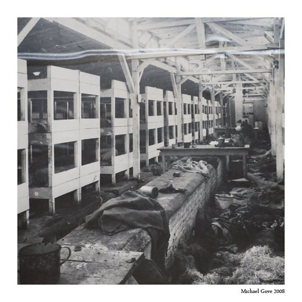 Original images of wooden barracks taken just after the camp was liberated (94649534).jpg