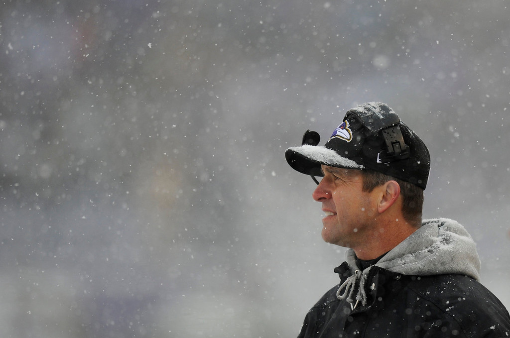 . Baltimore Ravens head coach John Harbaugh watches action as snow falls in the first half of an NFL football game against the Minnesota Vikings, Sunday, Dec. 8, 2013, in Baltimore. (AP Photo/Nick Wass)