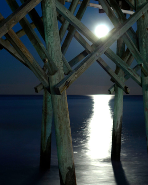 The moon, a waning gibbous, rises over Pier 14 and the Atlantic Ocean in Myrtle Beach, South Carolina on Saturday, January 22, 2011. Photo Copyright 2011 Jason Barnette