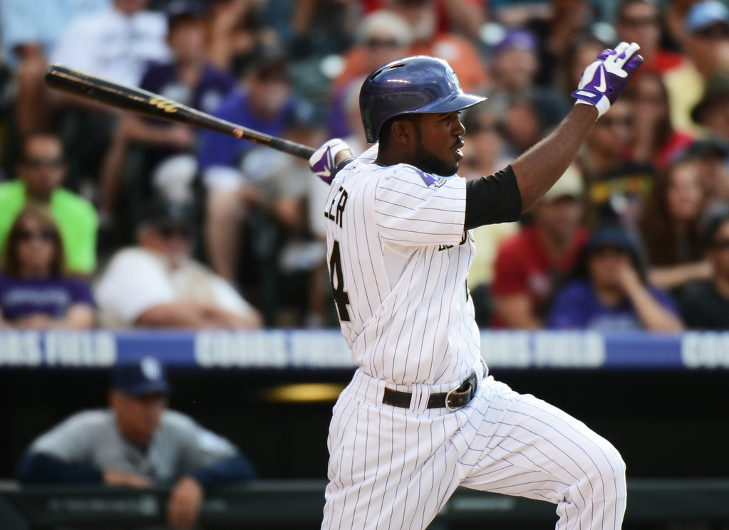 . Denver, CO. - June 08: Dexter Fowler of Colorado Rockies (24) singles in the 1st inning of the game against San Diego Padres at Coors Field. Denver, Colorado. June 8, 2013.  (Photo By Hyoung Chang/The Denver Post)
