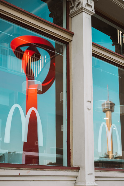 Mc Donalds Arches and city reflections.jpg