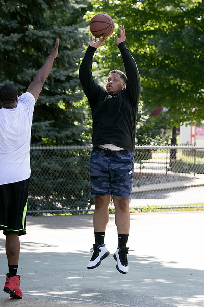 "Friends got together on Saturday to shoot some hoops at the Joanne ""Mama"" fitz Memorial Playground's basketball court. Putting up a shot is Mike Jhons from Fitchburg. SENTINEL & ENTERPRISE/JOHN LOVE"