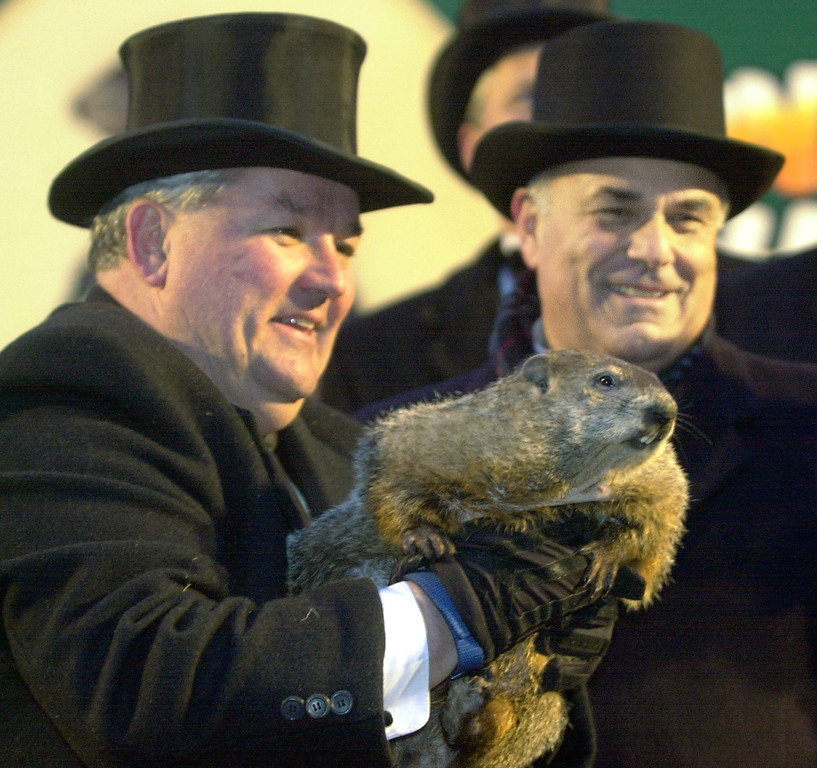 . ** CORRECTS NAME OF HANDLER TO BILL DEELEY, NOT BILL FEELEY IN AP PHOTOS KBS101 AND KBS102 TRANSMITTED FEB. 2, 2003 ** Weather predicting groundhog, Punxsutawney Phil is held by handler Bill Deeley, right, with Pennsylvania Gov. Ed Rendell,left, after Groundhog Club President Bill Cooper said Phil saw his shadow and Winter will continue for six more weeks in Punxsutawney, Pa. on Sunday, Feb. 2, 2003. (AP Photo/Keith Srakocic)
