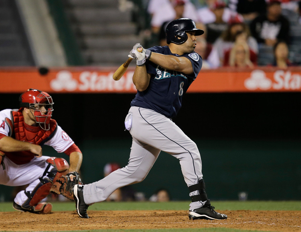 . Seattle Mariners\' Kendrys Morales hits a RBI single against the Los Angeles Angels during the 10th inning of a baseball game in Anaheim, Calif., Tuesday, June 18, 2013. (AP Photo/Jae C. Hong)