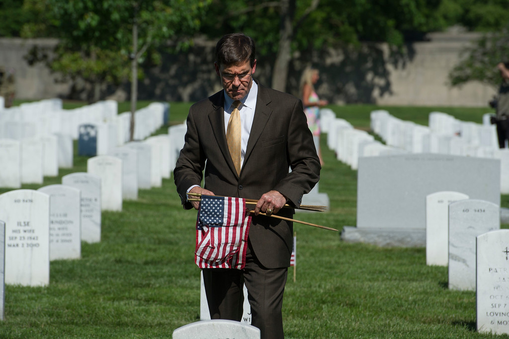 . Secretary of the Army Mark Esper places flags at gravesite as members of the Army 3d U.S. Infantry Regiment, The Old Guard, honor the nation\'s fallen military heroes during its annual Flags In ceremony at Arlington National Cemetery, Thursday, May 24, 2018, in Arlington, Va. (AP Photo/Cliff Owen)