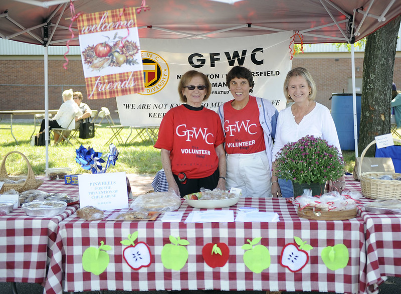 9/22/2012 Mike Orazzi | Staff Dottie Dee, Elizabeth Kostreva and Diane Rickenbacker at The General Federation of Women's Clubs booth during the Newington Waterfall Festival on Market Square on Saturday morning.