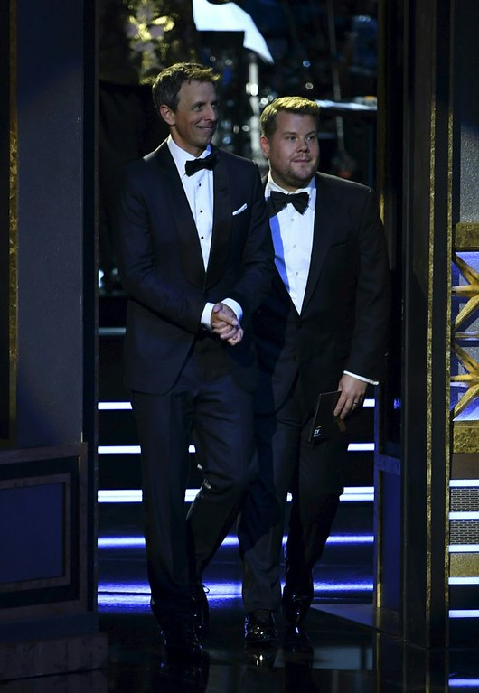 . Seth Meyers (L) and James Corden speak onstage during the 69th Emmy Awards at the Microsoft Theatre on September 17, 2017 in Los Angeles, California. (FREDERIC J. BROWN/AFP/Getty Images)