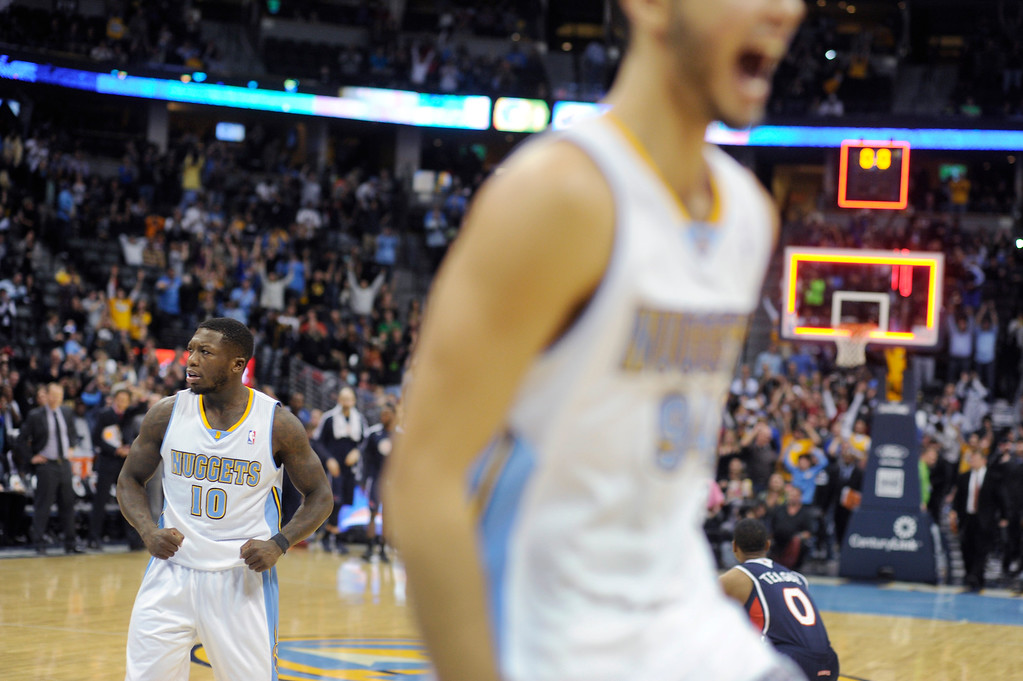 . Denver guards Nate Robinson and Evan Fournier celebrated the win Thursday night.   Photo By Karl Gehring/The Denver Post