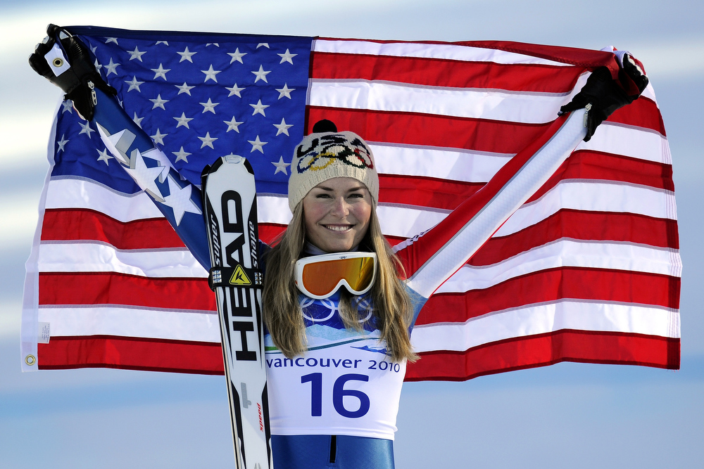 . USA\'s gold medallist Lindsey Vonn poses for photographers in the finish area during the Women\'s downhill event on February 17, 2010 at the Whistler Creekside Alpine skiing venue of the Vancouver 2010 Winter Olympics.  AFP PHOTO / FABRICE COFFRINI