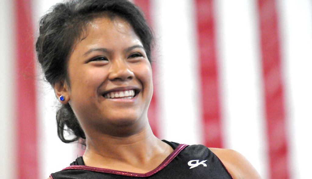 . An ebullient Mary Jane Rott is satisfied after performing a particularily complex set of exercises on the balance beam. The aspiring sports psychology and sports medicine double major already began summer classes on Monday at Auburn University. Rott wants to return home after college to be a coach or a personal trainer. (Pioneer Press: John Doman)