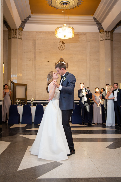 bride and groom sharing their first dance during their wedding reception