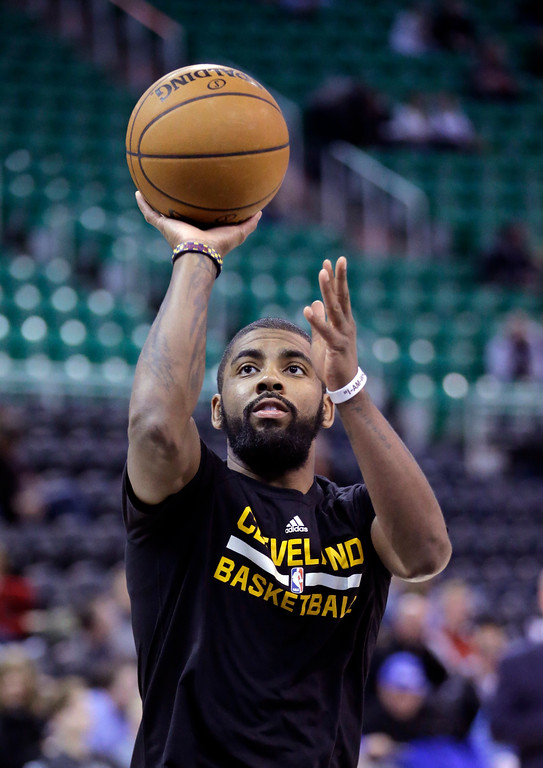 . Cleveland Cavaliers guard Kyrie Irving shoots during practice before the start of their NBA basketball game against the Utah Jazz Tuesday, Jan. 10, 2017, in Salt Lake City. (AP Photo/Rick Bowmer)