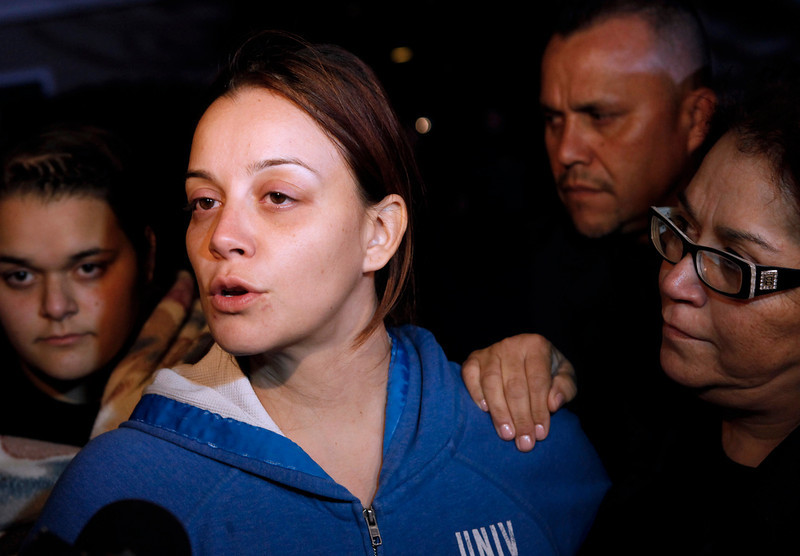. Rosie Rivera, sister of singer Jenni Rivera, speaks with their mother Rosa Rivera, right, during a news conference outside the home of Rivera\'s father in Lakewood, Calif., on Sunday, Dec. 9, 2012. Jenicka Lopez, 15, daughter of Jenni Rivera, watches at rear left. Authorities have not confirmed her death, but Riveraís relatives in the U.S. say they have few doubts that she was on the Learjet 25 that disintegrated on impact Sunday in rugged territory in Nuevo Leon state in northern Mexico. (AP Photo/Patrick T. Fallon)