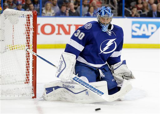 . Tampa Bay Lightning goalie Ben Bishop makes a pad save on a shot by the Detroit Red Wings during the first period of Game 1 of an NHL hockey first-round playoff series Thursday, April 16, 2015, in Tampa, Fla. (AP Photo/Chris O\'Meara)