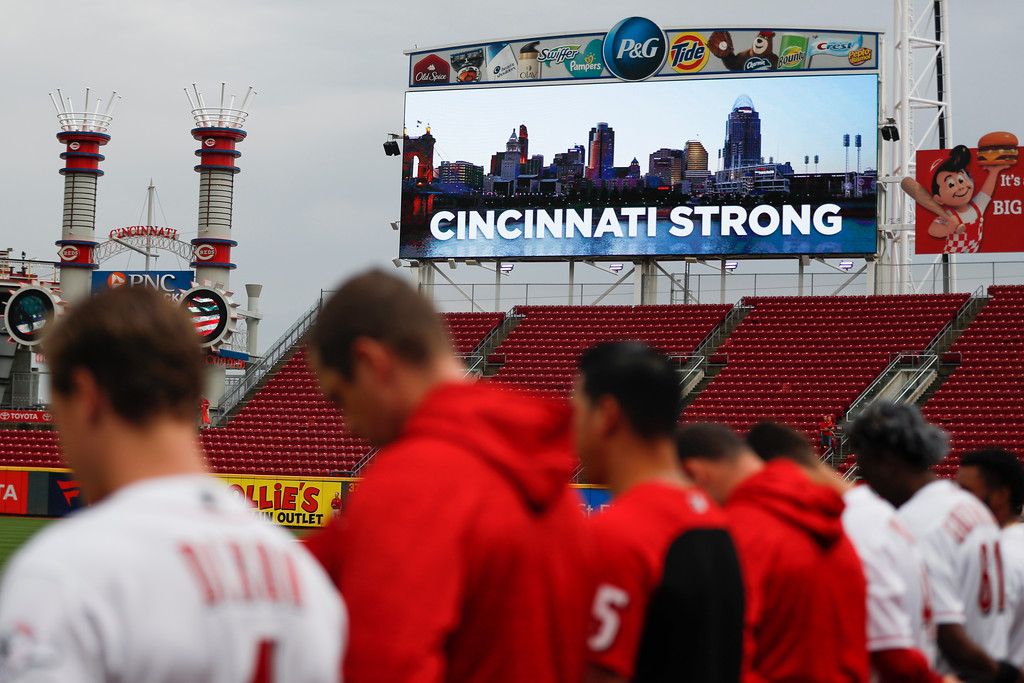 . A moment of silence is observed for the three dead and others wound in a shooting downtown, at Great American Ball Park before a baseball game between the Cincinnati Reds and the San Diego Padres, Thursday, Sept. 6, 2018, in Cincinnati. (AP Photo/John Minchillo)