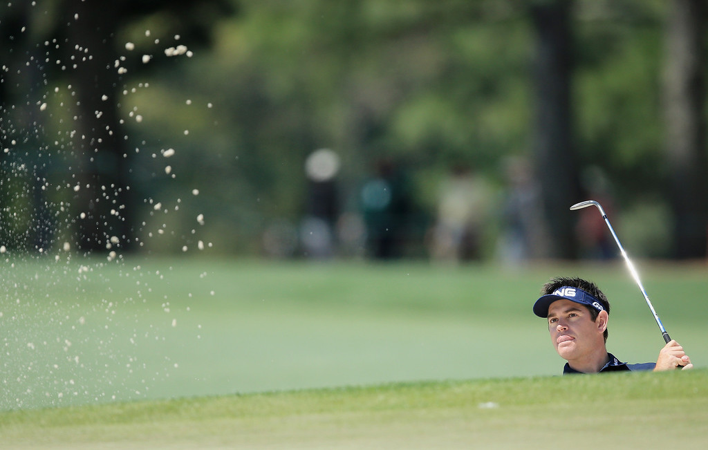 . Louis Oosthuizen of South Africa hits a shot out of the sandtrap during a practice round prior to the start of the 2014 Masters Tournament at Augusta National Golf Club on April 9, 2014 in Augusta, Georgia.  (Photo by David Cannon/Getty Images)