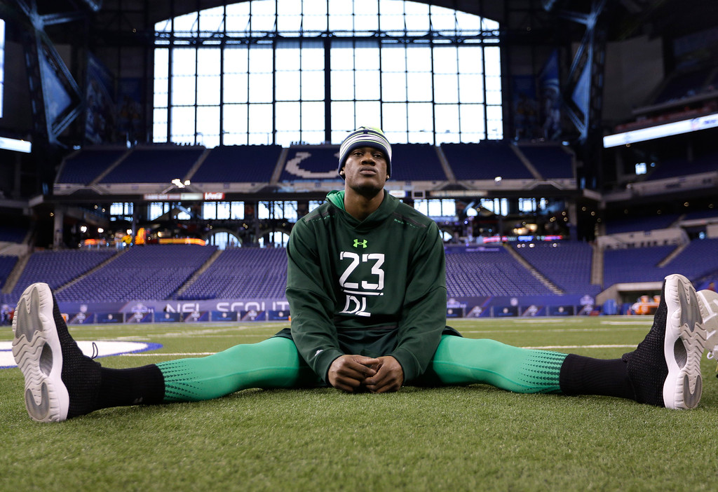 . Nebraska defensive lineman Randy Gregory stretches before drills at the NFL football scouting combine in Indianapolis, Sunday, Feb. 22, 2015. (AP Photo/David J. Phillip)