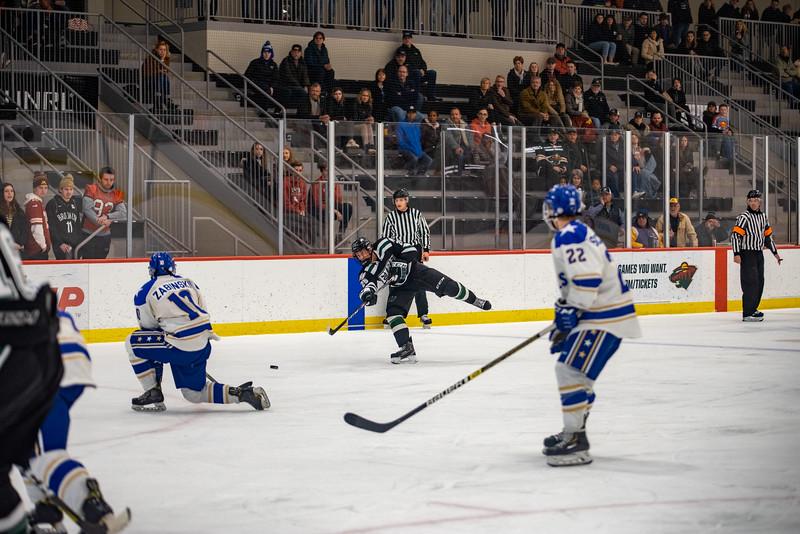 Holy Family Boys Varsity Hockey vs. Academy of Holy Angels, 12/21/19: Bishop Schugel '21 (25)