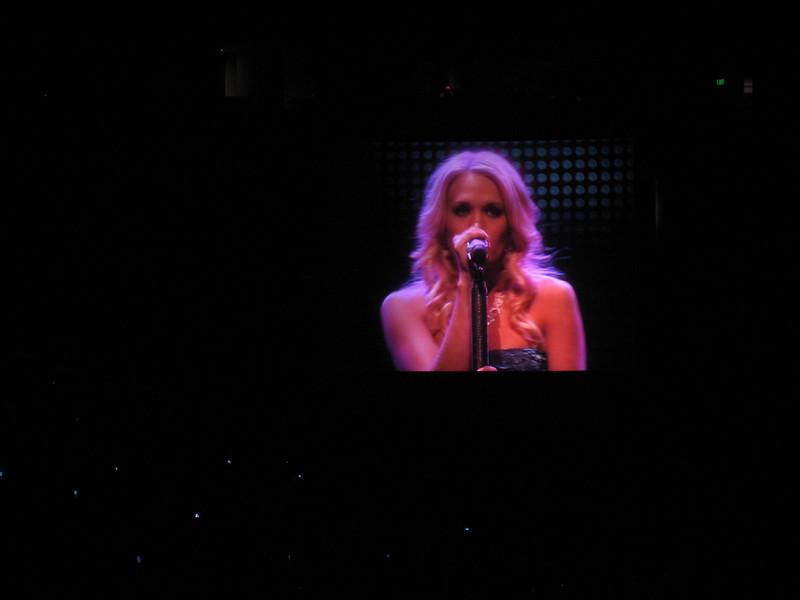 Carrie Underwood on a tv screen at the show -- now we can actually see her!