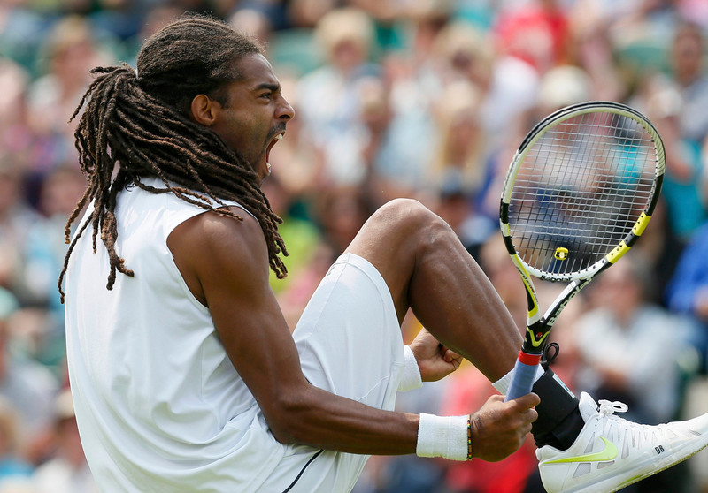 . Dustin Brown of Germany reacts during his men\'s singles tennis match against Lleyton Hewitt of Australia at the Wimbledon Tennis Championships, in London June 26, 2013.       REUTERS/Stefan Wermuth