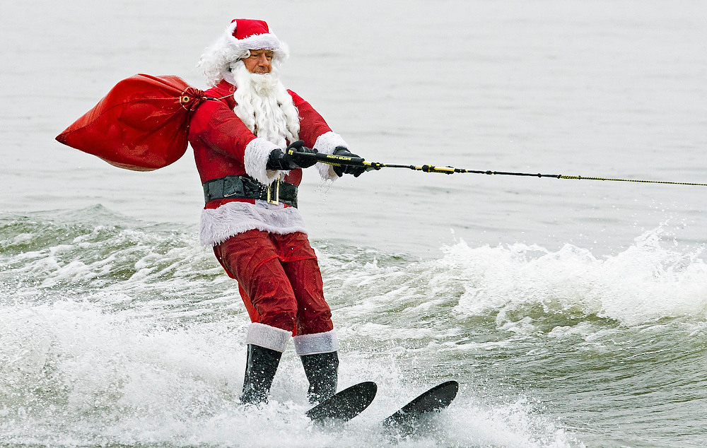 . Santa Claus water-skis on the Potomac River near Washington, DC, on December 24, 2012, at the National Harbor in Maryland during th 27th Annual Water Skiing show. This unusual annual event features a water-skiing Santa, flying elves, the Jet-skiing Grinch, and Frosty the Snowman performing on the Potomac River.   PAUL J. RICHARDS/AFP/Getty Images