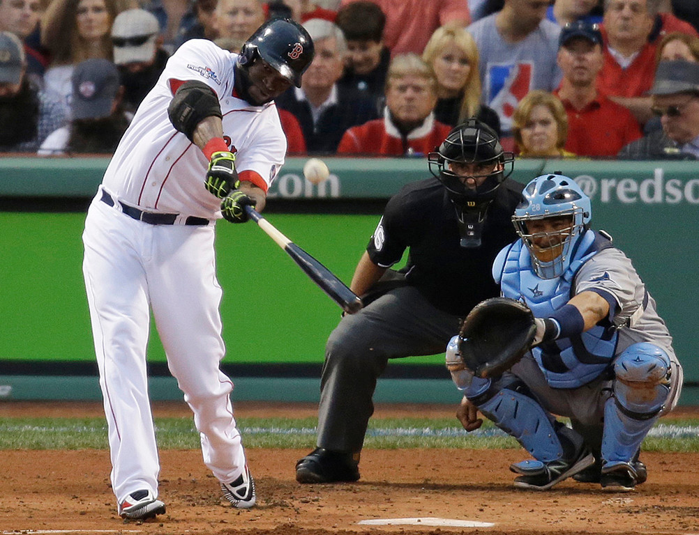 . Boston Red Sox\'s David Ortiz hits a solo home run off Tampa Bay Rays starting pitcher David Price in front of Rays catcher Jose Molina during the first inning in Game 2 of baseball\'s American League division series, Saturday, Oct. 5, 2013, in Boston. (AP Photo/Stephan Savoia)