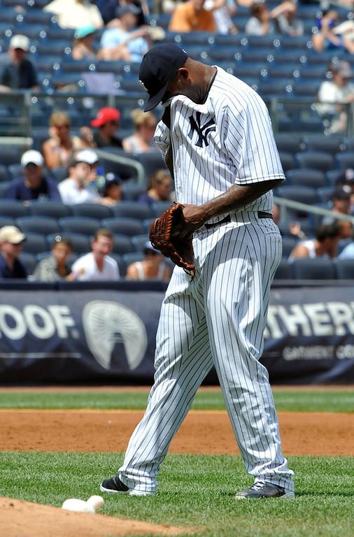 . Yankees starting pitcher C.C. Sabathia reacts after Minnesota\'s Aaron Hicks hit a three-run home run in the third inning. (AP Photo/Kathy Kmonicek)