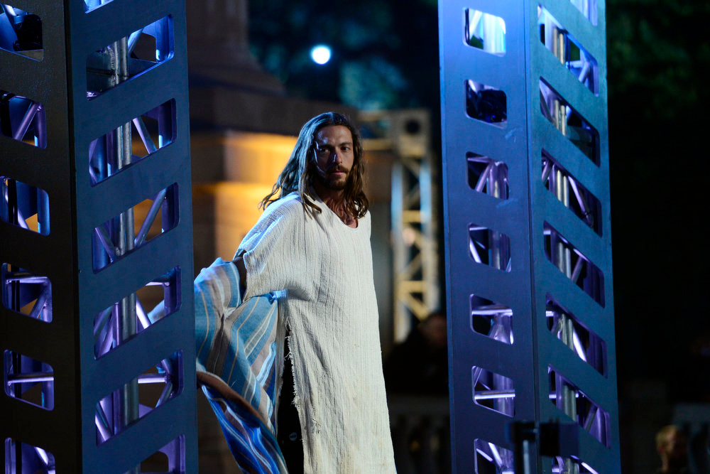 . Isaac Caldiero (dressed as Jesus Christ) gives the crowd hope before his tryout for American Ninja Warrior Denver. Caldiero dominated the course. (Photo by AAron Ontiveroz/The Denver Post)