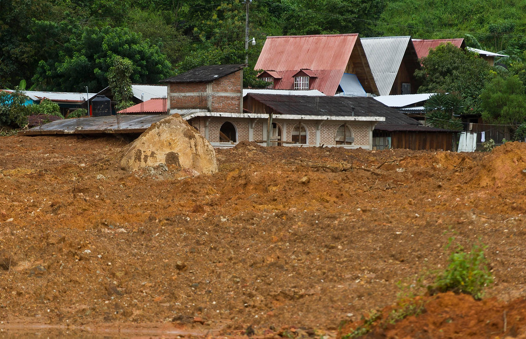 . The remains of a buried house can be seen after a landslide in La Pintada, state of Guerrero, Mexico, on September 19, 2013 as heavy rains hit the country.   AFP PHOTO/RONALDO  Schemidt/AFP/Getty Images